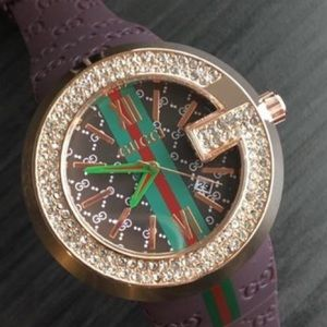 Gucci Brown watch with Rubber Straps.